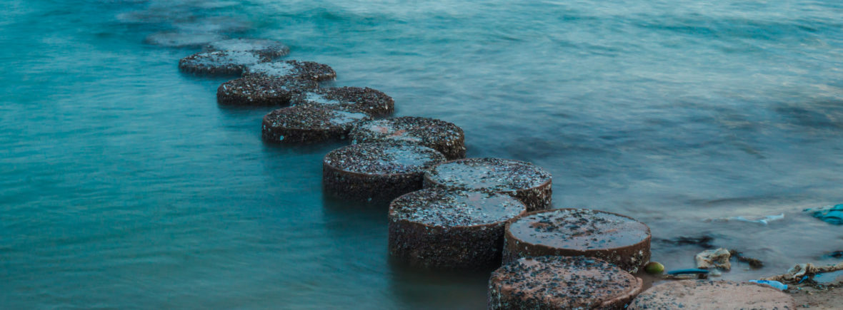 row of stones stepping on the sea